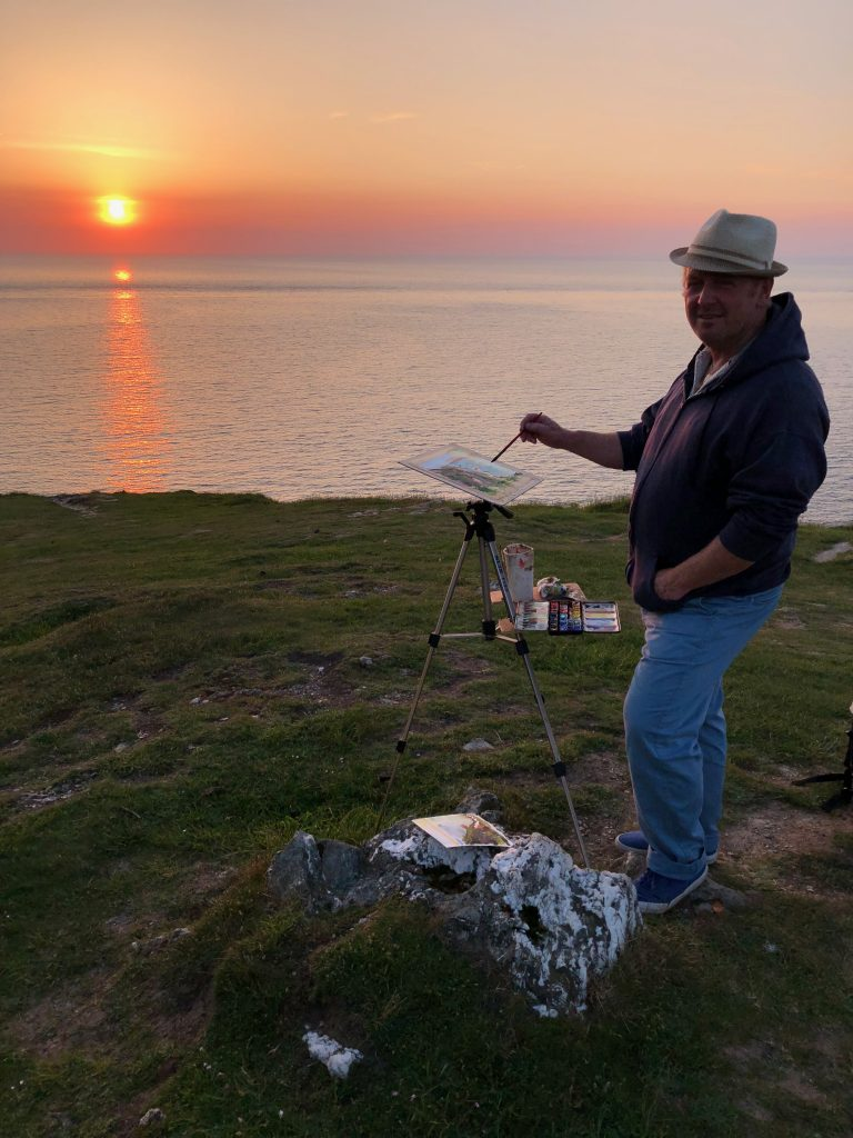 Steve PP painting the sunset on Morte Point Woolacombe